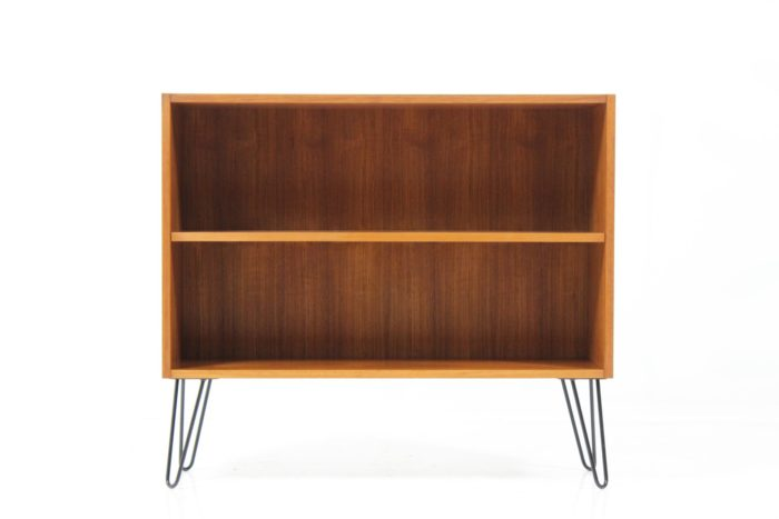 Article #: CZ2016324 Designer: Unidentified Producer: Unidentified Model: Unidentified Year: 1960's Dimensions: H 77 W 87,5 D 27 cm Origin: Denmark Location: Central warehouse, Czechia Price: € 270   Original medium shelf rack / bookcase in teak featuring adjustable shelf inside. The item has been redesigned with minimalist iron leg base. Carefully restored, very good condition.
